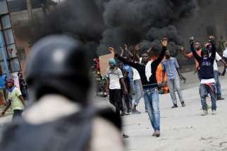 Protesters in Port-au-Prince, Haiti, clash with security forces Oct. 4, 2019, during a demonstration to demand the resignation of President Jovenel Moise. As Port-au-Prince began its fourth week of paralysis due to serious social unrest, the Haitian bishops' justice and peace commission called on Moise to step down.