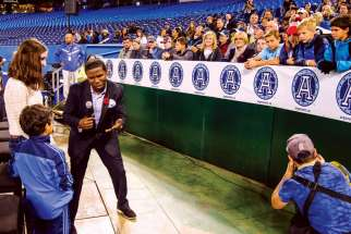 "Toronto Argonauts vice-chairman Michael ""Pinball"" Clemons interacts with fans on the team's Faith Night Nov. 7 at the Rogers Centre."