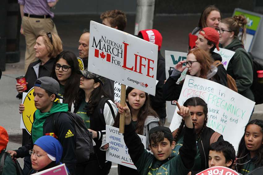 Young people marching during the 20th edition of the National March for Life in Ottawa May 11.