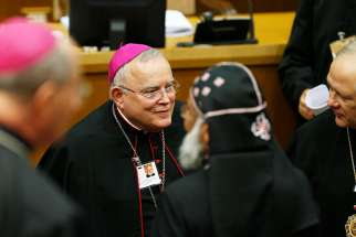 Archbishop Charles J. Chaput of Philadelphia arrives for the opening session of the Synod of Bishops on young people, the faith and vocational discernment at the Vatican Oct 3.