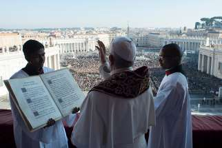 "Pope Francis delivers his Christmas blessing ""urbi et orbi"" (to the city and the world) from the central balcony of St. Peter's Basilica at the Vatican Dec. 25."