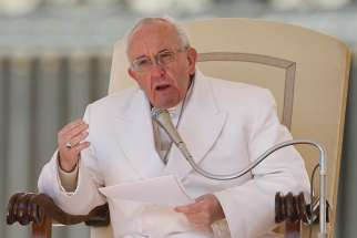 Pope Francis speaks during his general audience in St. Peter's Square at the Vatican April 19.