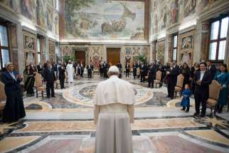 Pope Francis is greeted by 13 new ambassadors to the Holy See as they present their letters of credential at the Vatican Dec. 18. During the special audience, the pope expressed his joy over the historic turning point in U.S.-Cuba relations as the two countries agreed to restore diplomatic ties after half a century.