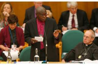 On Jan. 26, Anglican archbishop of York John Sentamu laid hands on the Rev. Libby Lane in an ordination ceremony. In this photo, Sentamu speaks as Archbishop Justin Welby of Canterbury, the leader of the worldwide Anglican Communion looks on during the Church of England's General Synod at Church House in central London Nov. 20. The Church of England's law-making body voted in favour of female bishops that day, a move that ended a 20-year impasse and could see women ordained as senior clergy.