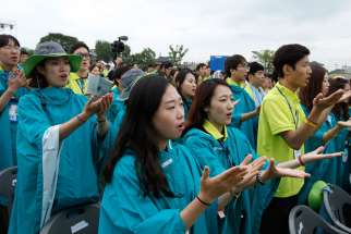 Young people pray as Pope Francis celebrates the closing Mass of the sixth Asian Youth Day at Haemi Castle in Haemi, South Korea, Aug. 17.