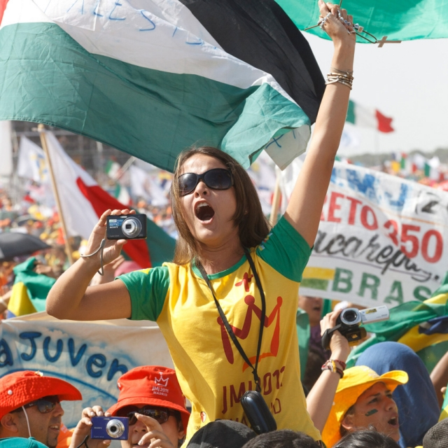 A Brazilian pilgrim cheers as Pope Benedict XVI announces that the next World Youth Day will be held in Rio de Janeiro in 2013.