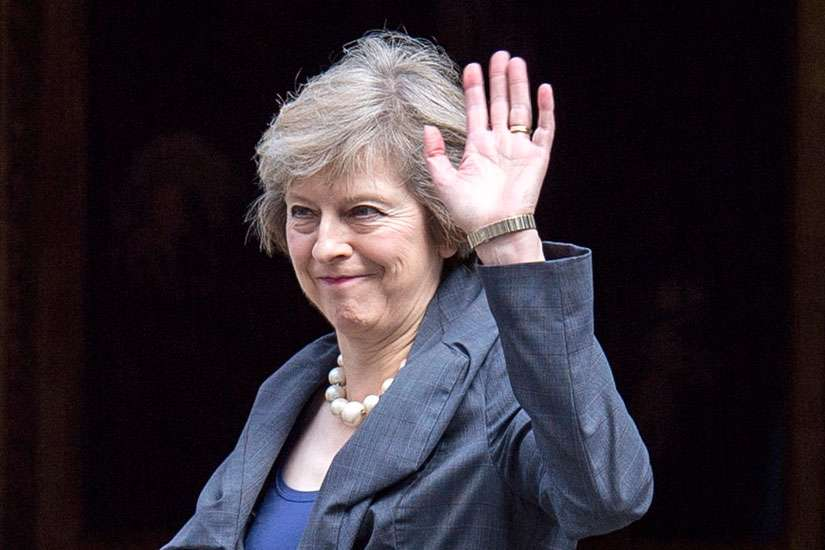 British Home Secretary Theresa May waves as she arrives July 12 to attend the last Cabinet meeting hosted by British Prime Minister David Cameron. Cardinal Vincent Nichols of Westminster said he is delighted by the appointment of May as Britain's new prime minister because of the commitment she has shown in the fight against human trafficking.