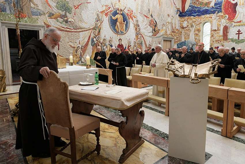Capuchin Father Raniero Cantalamessa, left, preacher of the papal household, prepares to give the last of his Friday Lenten meditations for Pope Francis and members of the Roman Curia in the Redemptoris Mater Chapel at the Vatican March 23.