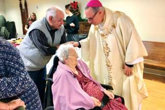 Bishop-elect Guy Desrochers greets residents at St. Joseph's Villa in Cornwall, Ont., where he concelebrated Mass of Our Lady Guadalupe with Archbishop Terrence Prendergast last month. He will serve the Ottawa archbishop as Auxiliary Bishop of Alexandria-Cornwall.