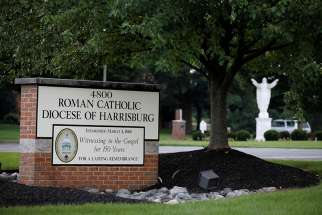 A statue of Christ and a sign are seen in late August at the entrance to the Diocese of Harrisburg in Pennsylvania.