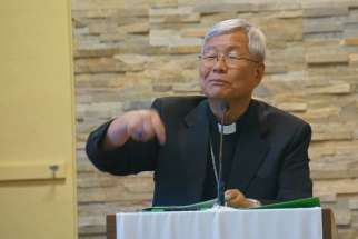 Daejeon Bishop Lazzaro You talks to parishioners at Holy Korean Martyrs in Ottawa July 15.