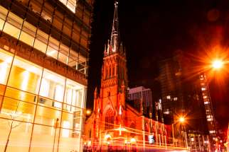 St. Michael's Cathedral in downtown Toronto lit up in red for the commemoration of Red Wednesday.