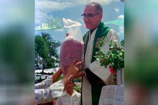 Archbishop Oscar Romero receives a sack of beans from parishioners following Mass outside of the church in San Antonio Los Ranchos in Chalatenango, El Salvador, in 1979. The Italian newspaper, Avvenire, reported today that Oscar Romero will be beatified in San Salvador on May 23, according to the chief promoter of Romero's sainthood cause, Italian archbishop Vincenzo Paglia.