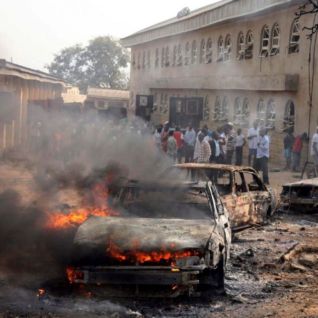 A car burns at the scene of a bomb explosion outside St. Theresa Catholic Church in Madalla, just outside Nigeria's capital Abuja, Dec. 25. Five bombs exploded Christmas Day at churches in Nigeria. The explosion at St. Theresa's killed at least 27 people . Militants of the Boko Haram sect said they had set off the bombs, raising fears that they are trying to ignite sectarian civil war.