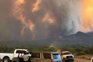 Smoke rises from the Goodwin Fire in the Prescott National Forest near Mayer, Ariz., June 29.