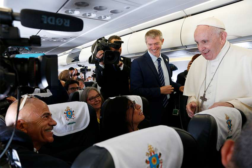 Pope Francis meeting journalists aboard his flight from Rome to Dublin Aug. 25