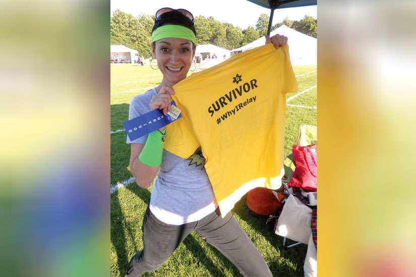 Jill Forester poses with her Survivor t-shirt at last year's Relay for Life fundraising event.