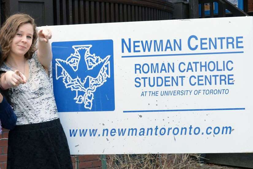 Kaylee Moynihan poses in front of her new residence at the Newman Centre on the University of Toronto downtown campus