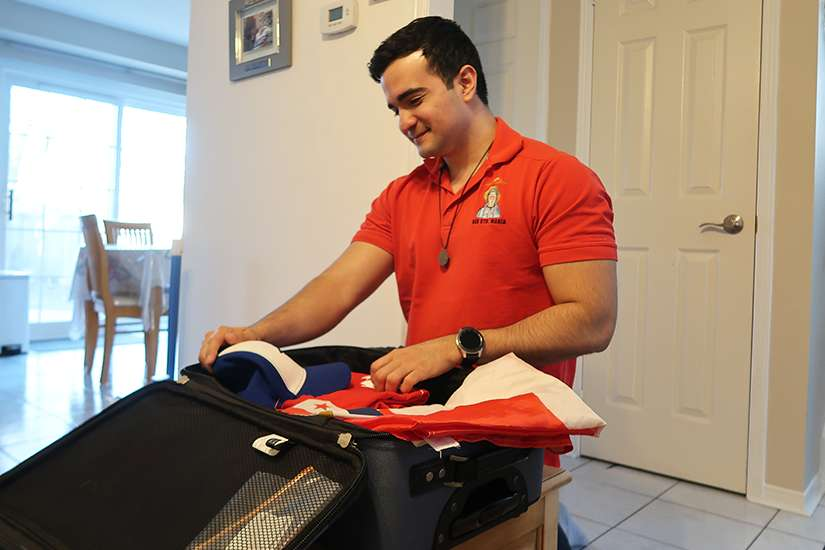 José Murillo packs his bag as he gets ready for his first World Youth Day in Panama City.