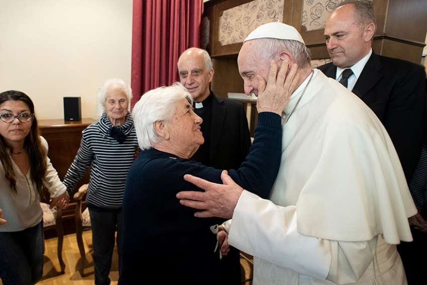 Pope Francis greets Emanuele Village residents April 12, 2019, in Rome. People who live there have Alzheimer's disease.