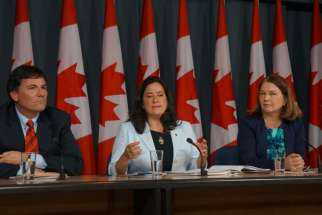 Government House Leader Dominic LeBlanc, Justice Minister Jody Wilson-Raybould and Health Minister Jane Philpott at a news conference on Parliament Hill April 14 after the tabling of Bill C-14 legalizing euthanasia and assisted suicide.