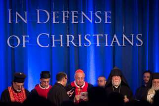 Cardinal Leonardo Sandri, prefect of the Congregation for Eastern Churches, leads a prayer during an ecumenical service at the Omni Shoreham Hotel in Washington Sept. 9.