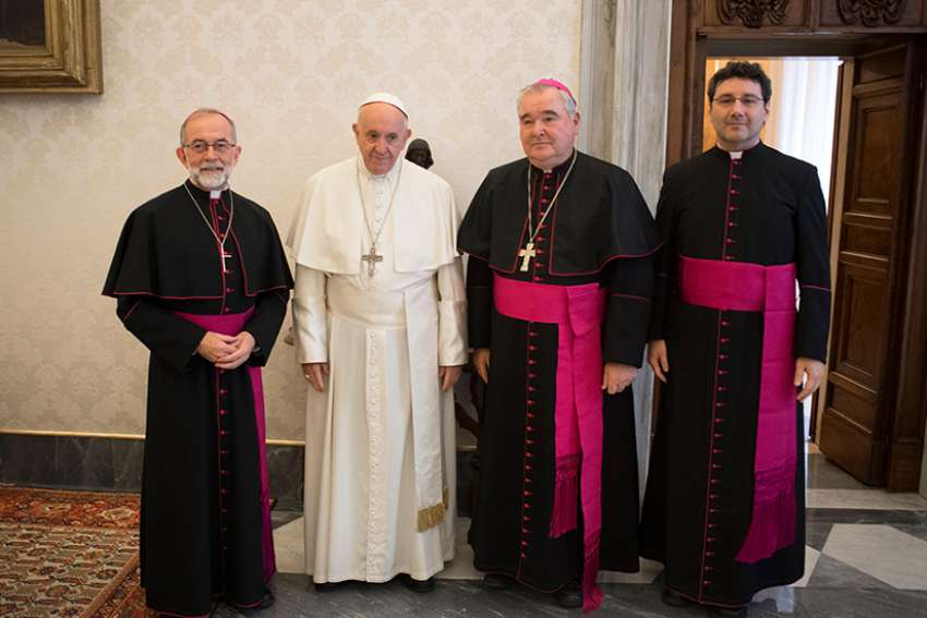 Pope Francis poses for a photo with representatives of the Canadian Conference of Catholic Bishops during a meeting at the Vatican Dec. 6. From left are Bishop Lionel Gendron of Saint-Jean-Longueuil, Quebec, CCCB president; Pope Francis; Archbishop Richard Gagnon of Winnipeg, Manitoba, CCCB vice president; and Msgr. Frank Leo Jr., general secretary of the conference.