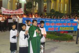 Song Ngoc Parish gather to pray for parishioners who were beaten by police by police while attempting to file a lawsuit Feb. 19. 11 of the parish's priest said in a June 13 petition that the local authorities have looked the other way as groups of youths have terrorized the community.