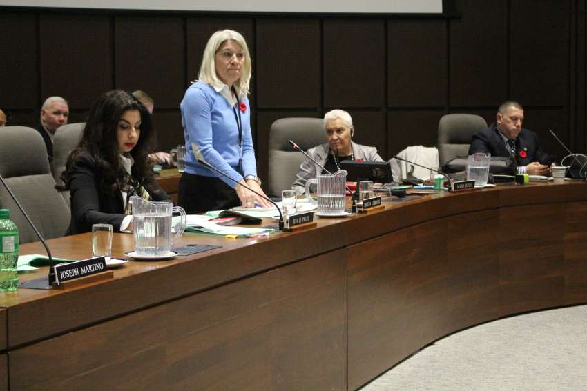 Teresa Lubinski addresses her fellow trustees at the Toronto Catholic District School Board meeting while Ida Li Preti, left, and chair Maria Rizzo look on.