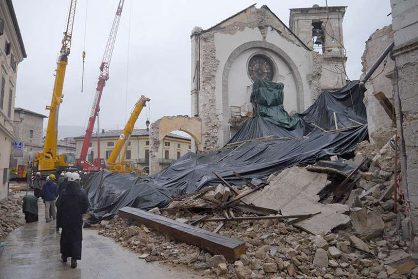 Monks from the Monastery of St. Benedict in Norcia, Italy, visit the site of their collapsed basilica, which was destroyed during the magnitude 6.5 earthquake that struck the town Oct. 30.