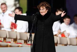 Scottish singer Susan Boyle performs at Bellahouston Park in Glasgow Sept. 16 before the arrival of Pope Benedict XVI. The pope was on a four-day visit to Great Britain.