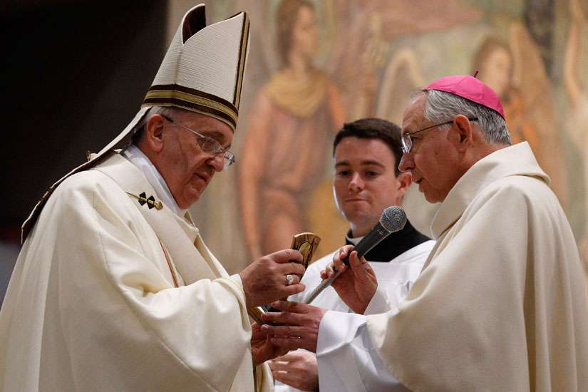 Pope Francis accepts a relic of Blessed Junipero Serra from Archbishop Jose H. Gomez of Los Angeles at the conclusion of Mass celebrated at the Pontifical North American College in Rome May 2. It was the first papal visit to the U.S. seminary since 1980. The Pope said that while some people seem to relish the idea of listing Bl. Serra's defects, he wondered how many would have the courage he had to leave everything and preach the Gospel.