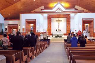 People attend Mass at St. Matthew's Church in Surrey, B.C.