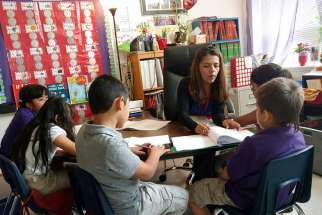 Teacher Maria Dominguez works with students at Rodriguez Elementary School in Austin, Texas. Dominguez said there is fear and anxiety among her students and their parents, many of whom are in the country illegally, over the Trump administration's immigration proposals.