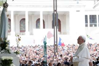 Pope Francis prays in the Little Chapel of the Apparitions at the Shrine of Our Lady of Fatima in Portugal, May 12. The pope was making a two-day visit to Fatima to commemorate the 100th anniversary of the Marian apparitions and to canonize two of the young seers.