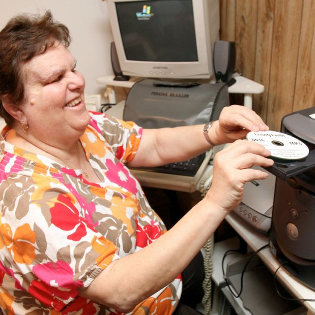 Carmen Greico, the folk choir director at St. Bernard Church in Levittown, N.Y., prepares to listen to a CD of daily reflections at her home in Levittown June 29. The CD is produced and distributed by the Xavier Society for the Blind