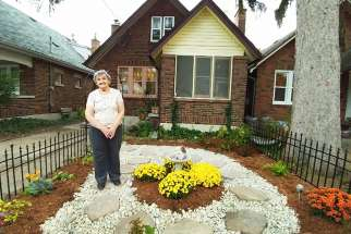 Bess Srahulek showcases her new garden. Students and neighbours worked to repair the damage to her garden caused by a rowdy homecoming street party.