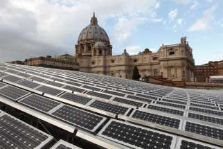 Solar panels are seen on the roof of the Paul VI audience hall at the Vatican in this Dec. 1, 2010, file photo. In a videomessage, Pope Francis told the Virtual Climate Ambition Summit that Vatican City is aiming for net zero carbon emissions.