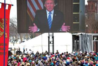 A videotaped message from President Donald Trump is broadcast during the annual March for Life rally in Washington Jan. 18.