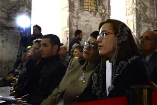 Chaldean Christians in Mosul, Iraq, attend Christmas Mass at St. Paul Cathedral Dec. 24, 2017.