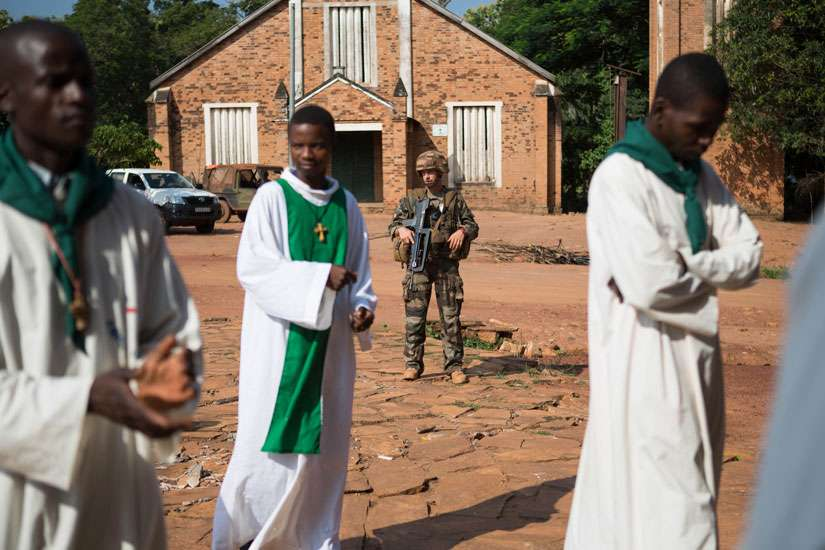 A French soldier stands guard in 2014 outside St. Joseph Cathedral in Bambari, Central African Republic. A church leader confirmed Pope Francis will visit the Central African Republic later this year in an effort to end two years of intercommunal conflict.