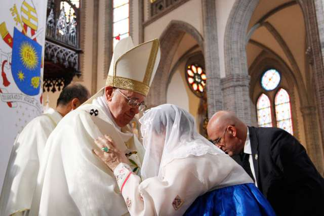 Pope Francis embraces a former sex slave, or comfort woman, as he celebrates a Mass for peace and for the reconciliation of North and South Korea at Myongdong Cathedral in Seoul, South Korea, Aug. 18.