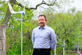 Neil McNeil high school teacher Joe Ferro hopes exposing his students to renewable energy technology today will lead to a brighter future tomorrow. Ferro created and installed the wind turbine and the students added the school logo to the tail fin.