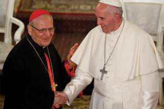Pope Francis greets Cardinal Louis Sako, the Baghdad-based patriarch of the Chaldean Catholic Church, in Tbilisi, Georgia, in this Sept. 30, 2016, file photo. Sako said the Church in Iraq is working with the government to prepare for Pope Francis' planned March 5-8 visit to Iraq.