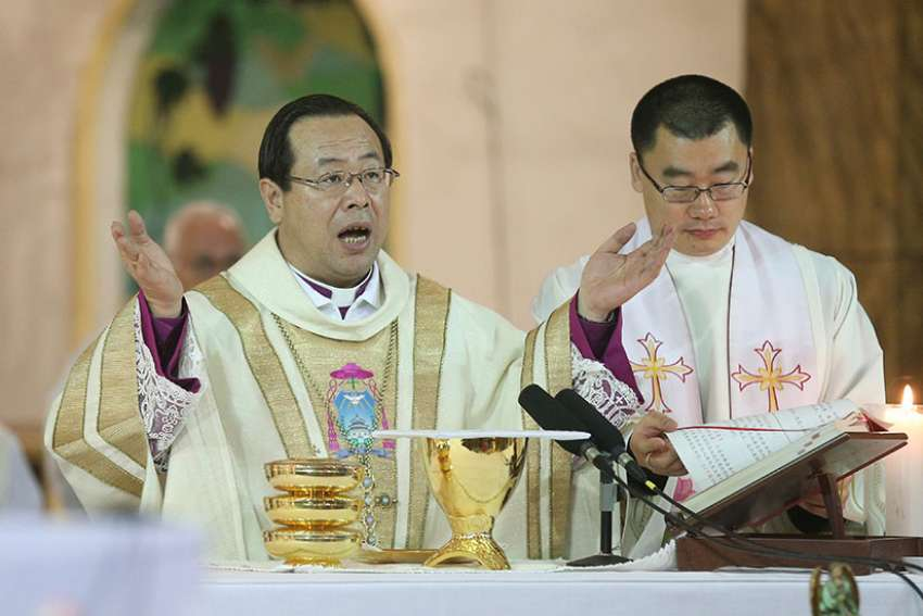 Bishop Joseph Li Shan of Beijing celebrates Mass in 2016 at the Cathedral of the Immaculate Conception. A senior Vatican official has hinted there is an unofficial agreement between the Holy See and Beijing on the appointment of bishops even as negotiations to formalize arrangements continue to hit roadblocks.