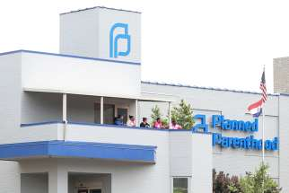 Planned Parenthood employees stand outside the facility during protests in St. Louis May 31, 2019.