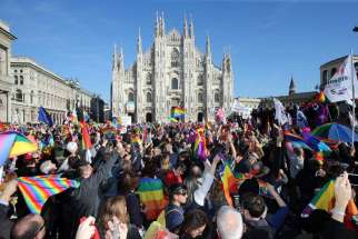 Demonstrators take part in a protest for gay rights in late February outside Italy's Milan Cathedral. The Italian government's approval of a controversial bill that grants legal recognition to non-married heterosexual and homosexual couples is a defeat for democracy and family life, an Italian bishop said.