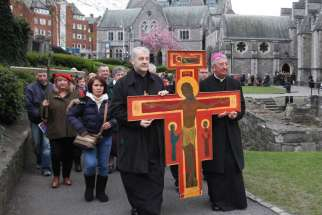 Anglican Archbishop Michael Jackson and Archbishop Diarmuid Martin of Dublin lead an ecumenical Good Friday procession in 2012 in Dublin. Archbishop Martin confirmed that Pope Francis, or his successor, will visit Ireland in 2018 for the World Meeting of Families.