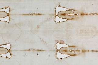 A detail view of the Shroud of Turin is seen in 2015 during a preview for journalists at the Cathedral of St. John the Baptist in Turin, Italy. A leading expert on the cloth, believed to be the burial shroud of Jesus, dismissed a new study claiming that blood patterns on the shroud are not consistent with those left by a crucified person.