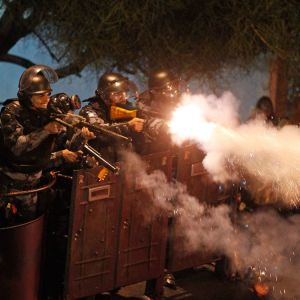 Riot police fire rubber bullets at demonstrators during clashes near Rio de Janeiro's Guanabara Palace, where Pope Francis met with Brazilians politicians July 22. Demonstrators are continuing their anti-government protests, which began in June amid grow ing economic and social dissatisfaction in Brazil.